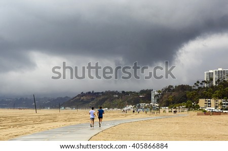 Pedestrian path for Jogging on the beach in Los Angeles. Beach landscape in the U.S. in bad weather.  - stock photo