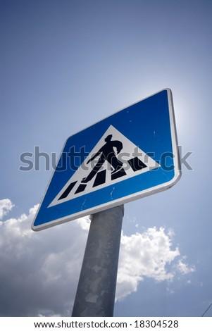 pedestrian roadsign over blue sky - stock photo