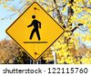 Pedestrian sign in a sunny day of Fall - stock photo
