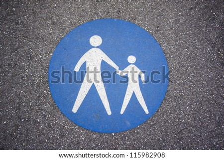 Pedestrian sign on the road - stock photo