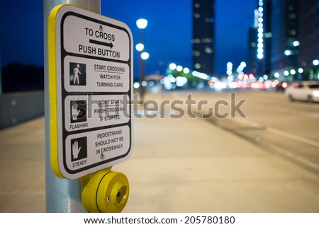 Pedestrian sign with traffic control during the night - stock photo