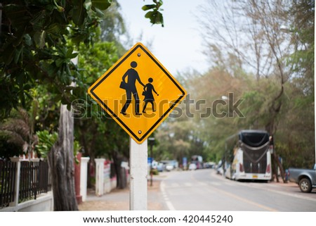 pedestrian signs ,  yellow signs , road car and tree background