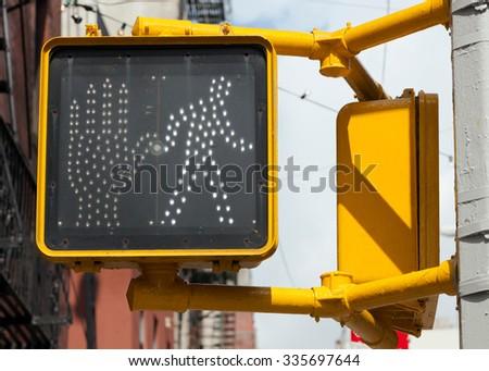 Pedestrian traffic light in New York, it's OK to cross. - stock photo