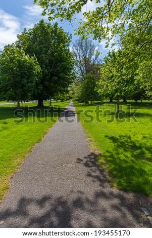 Pedestrian walk in Phoenix Park in Dublin Ireland - stock photo