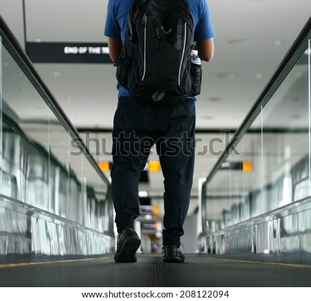 Pedestrian walking with zooming motion blur - stock photo
