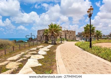 Pedestrian walkway, lampposts and ancient on promenade along Mediterranean sea coastline in Ashqelon, Israel. - stock photo