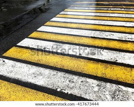 pedestrian zebra crossing in wet rainy weather - stock photo