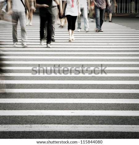 Pedestrians crowd in city street abstract blur - stock photo