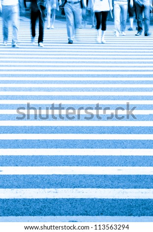 Pedestrians in modern city street abstract blur - stock photo