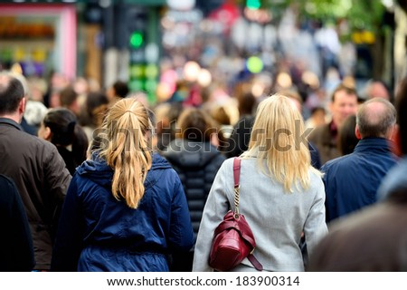 Pedestrians / shoppers on street - stock photo