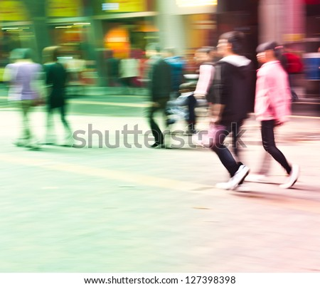 pedestrians walking in the streets in the modern city - stock photo
