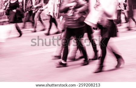 Pedestrians walking street during rush hour in urban business area