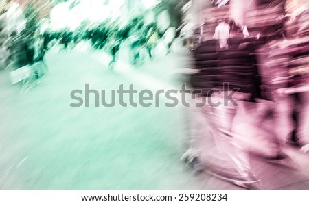 Pedestrians walking street during rush hour in urban business area - stock photo