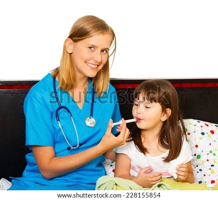 Pediatrician administrating daily syrup dose for little patient. - stock photo