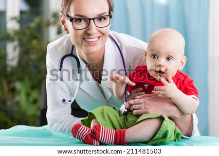Pediatrician and little patient during medical appointment