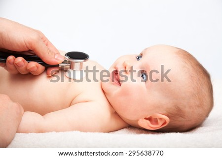 Pediatrician examines three month baby girl. Doctor using a stethoscope to listen to baby's chest checking heart beat. Child is looking at a doctor - stock photo
