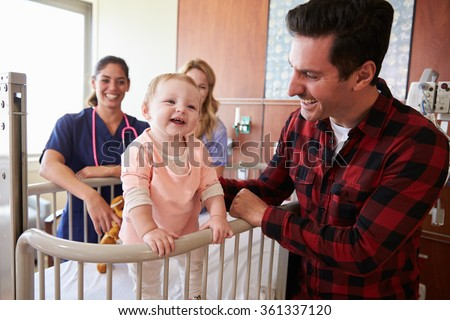 Pediatrician Visiting Parents And Child In Hospital Bed - stock photo