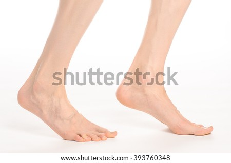 Pedicure and foot care topic: the naked man's legs isolated on white background in studio - stock photo