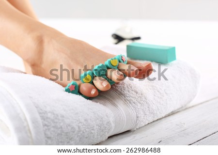 Pedicure, cut peel, a woman at the beautician. Foot care treatment and nail, the woman at the beautician for pedicure. - stock photo