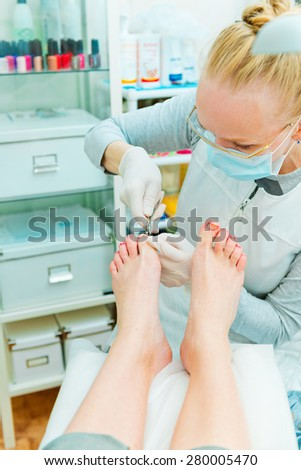 Pedicure in process - stock photo