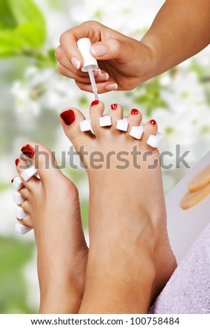 Pedicure in the spa salon in the garden