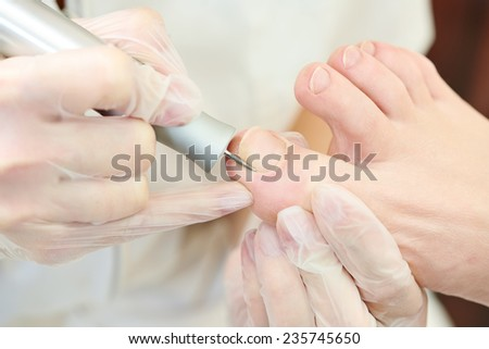 Pedicure nail procedure for foot care in beauty salon