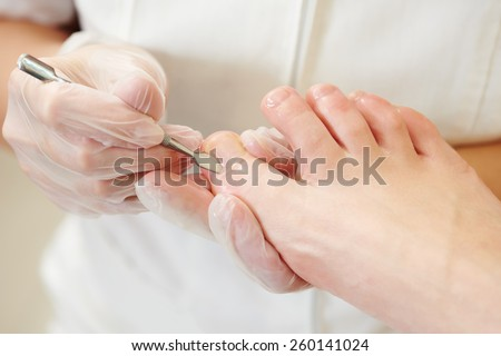 Pedicure nail procedure for foot care in beauty salon - stock photo
