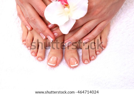 pedicure on legs and beautiful manicure  hands closeup