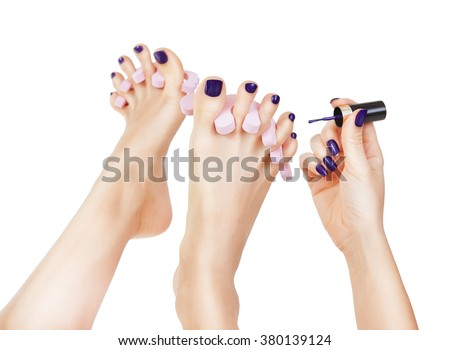 pedicure process - purple manicure and pedicure. Makeup, fashion, beauty. Beautiful long female sexy legs with purple pedicure and hands with purple manicure - stock photo