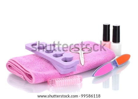 Pedicure set on pink towel isolated on white