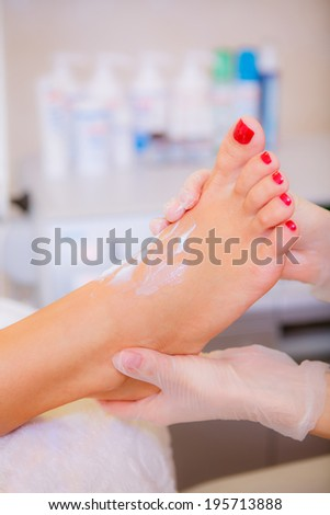 Pedicure, spa treatment for the feet, legs, skin care,  a girl in a beauty salon, body care - stock photo