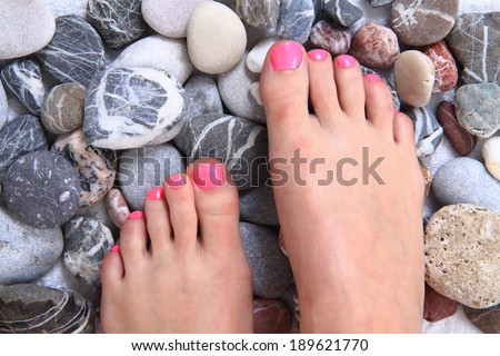 pedicure - women feet and stones - stock photo