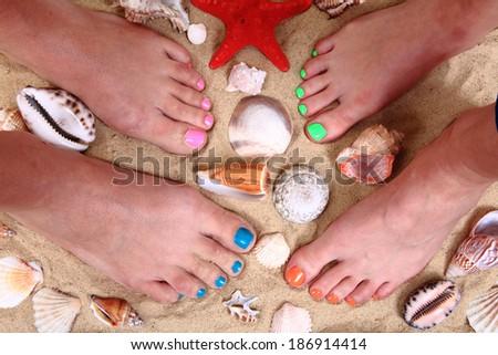 pedicure - women feet, sand, sea shells - stock photo