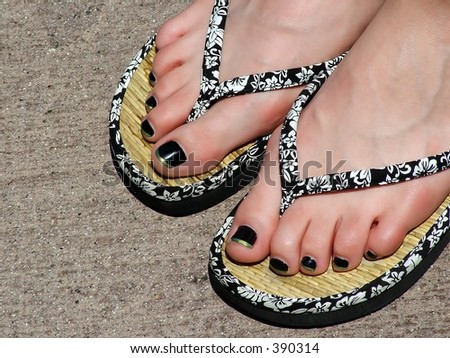 Pedicured Toes in sandals - stock photo