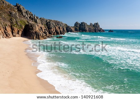 Pedn Vounder Beach with Treryn Dinas headland also called Logans Rock, Cornwall England UK
