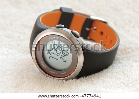 Pedometer sport watch on an white towel