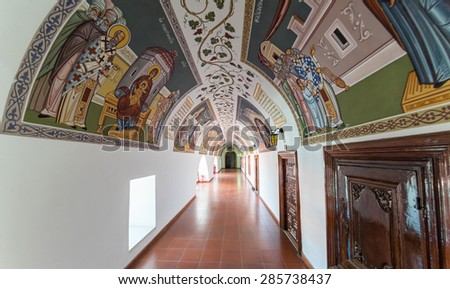 PEDOULAS, CYPRUS - APRIL 29: Fisheye view on ancient Kykkos Monastery (1081) passage ornate by icons on April 29, 2015 in Pedoulas.