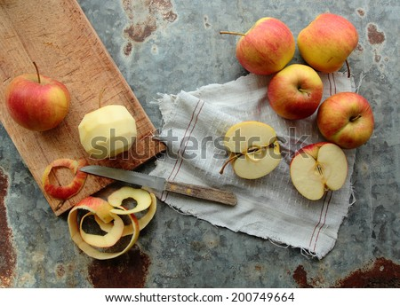 Peel and sliced apples on a kitchen board - stock photo
