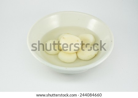 Peel raw chinese water chestnut in syrup on bowl - stock photo