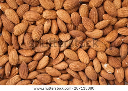 Peeled almonds closeup. For vegetarians. - stock photo
