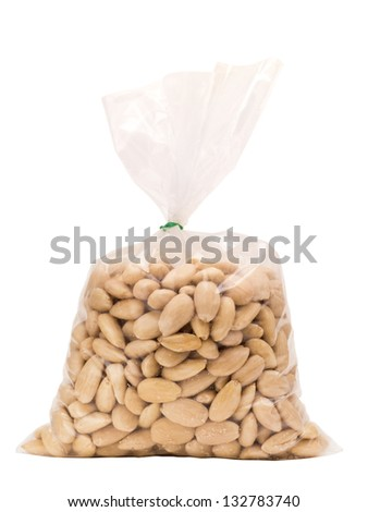 Peeled almonds isolated on white in bag with clipping path - stock photo