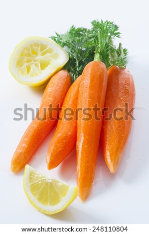 Peeled fresh carrots with tops. New version. - stock photo