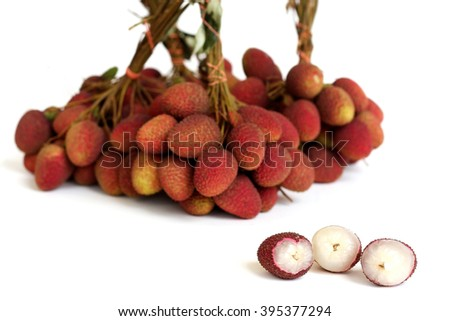 Peeled fresh Lychees with blurred bunch of lychee on white background.