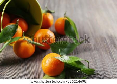 Peeled fresh mandarin on wooden table, closeup - stock photo