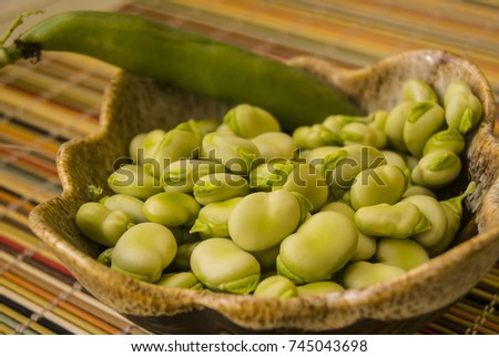 peeled green beans in a bowl, ready for cooking