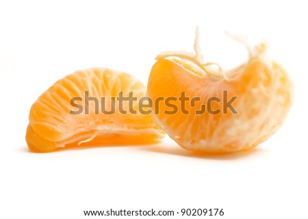 peeled mandarin / tangerine / clementine segments isolated on white background