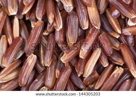 Peeled red rice close up