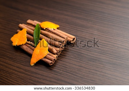 Peeled tangerine and cinnamon sticks, segments isolated on white background
