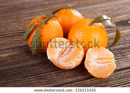 Peeled tangerines on a wooden table