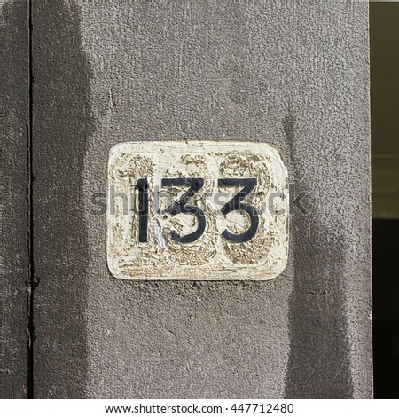 peeling house number one hundred and thirty three - stock photo